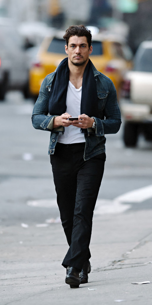 David Gandy seen wearing a denim jacket and blue scarf while enjoying an evening stroll in NYC