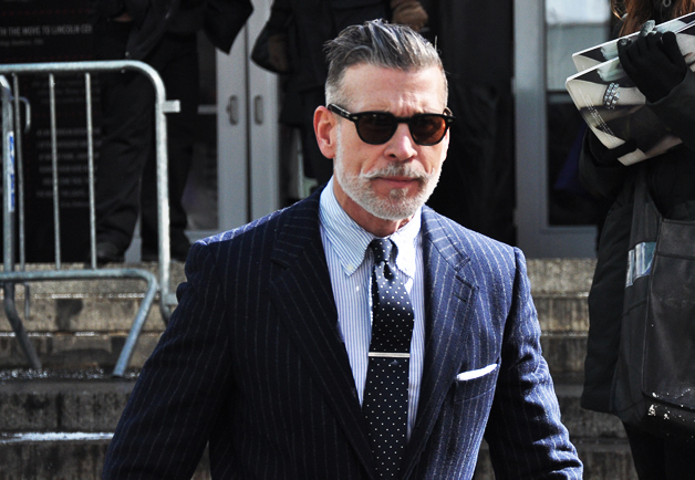 Nick Wooster wearing a suit and dotted tie